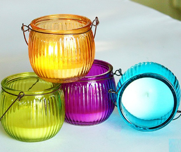 multi color scented candle In glass jar